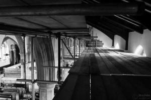 scaffolding near rafters inside church