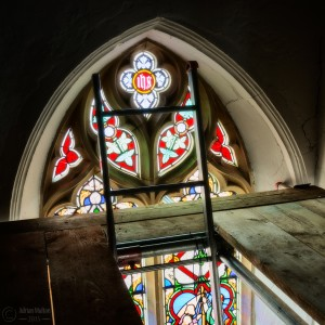 stained glass window and ladder
