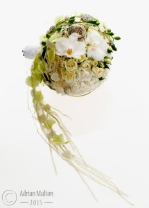 flower arrangement against off-white background