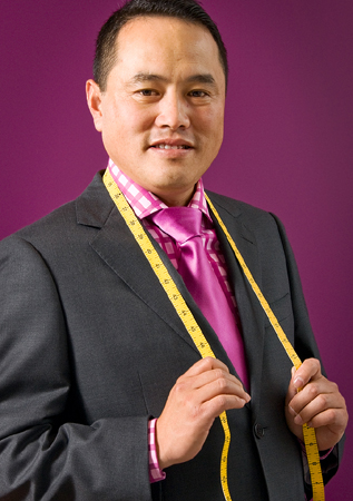 business portrait of tailor with tape measure